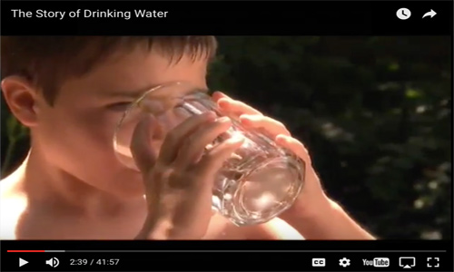 Child drinking water in video