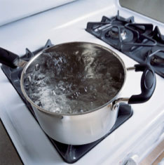 pan of boiling water on stove